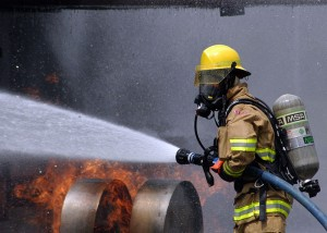 US_Navy_080730-N-5277R-003_A_Commander,_Naval_Forces_Japan_firefighter_douses_a_fire_on_a_dummy_aircraft_during_the_annual_off-station_mishap_drill_at_Naval_Support_Facility_Kamiseya